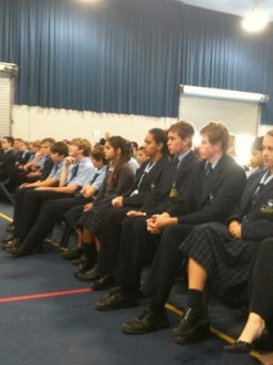 Students at Faith Lutheran College listening to Father Dini