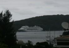 Port Vila harbour. Visitors arrive on a rare cloudy day.