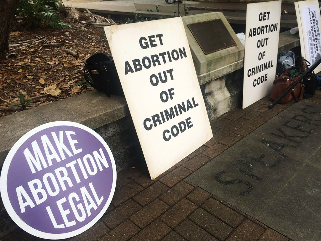 Abortion decriminalization rally draws crowd at QLD State Parliament