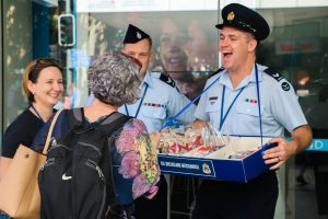 Members of the Royal Australian Air Force encouraging community members to donate and purchase. Photo by Leia Comegna