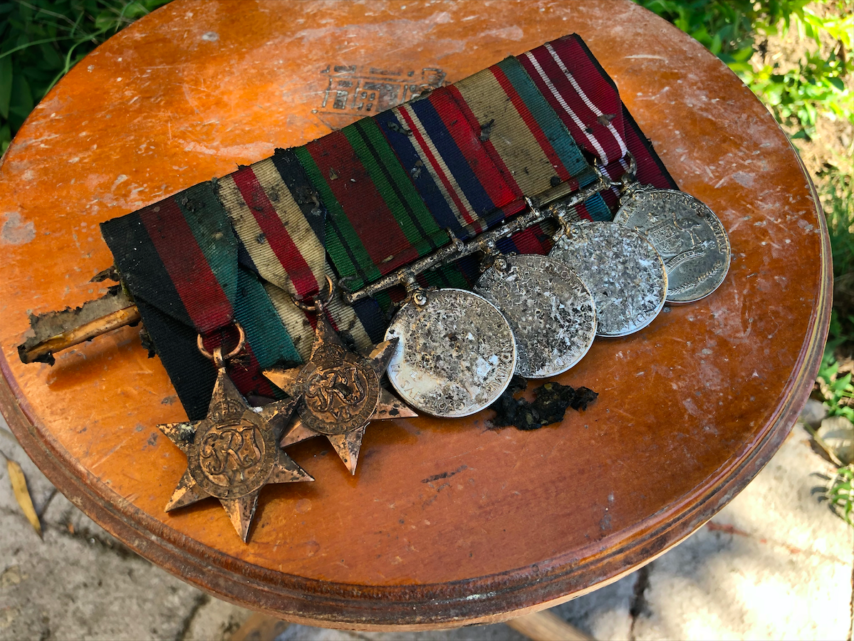 Mr Jackson's precious war medals from WWII were saved from the fire, however one of the six is still missing.