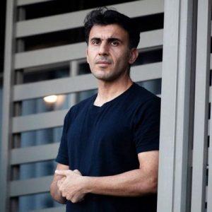 Farhad Rahmati stands on the balcony at the Kangaroo Point Central Hotel & Apartments
