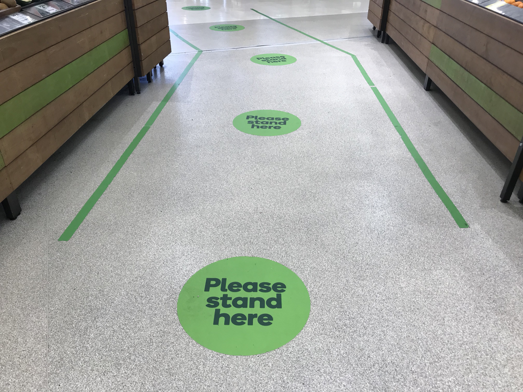 Social distancing markers on the floor at Woolworths.